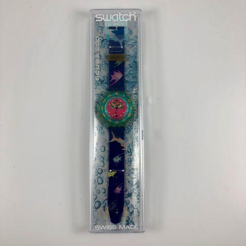 """SWATCH  Vers 1991.  Réf: SDN100.  Montre bracelet type scuba modèle """"Blue Moon"""".…"""