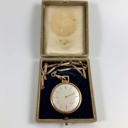 阿诺德  约1960年。  750/1000黄金材质的古赛,圆形表壳,签名为bmanc的表盘,巴顿时标,鎏金指针。镀金的黄铜链条。机械机芯,手动上链。  运作,…
