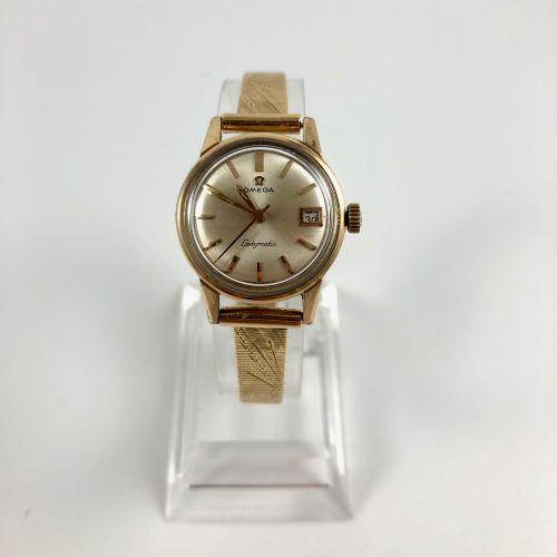 OMEGA Ladymatic Vers 1950. Montre bracelet en plaqué or jaune, boitier rond, cad…