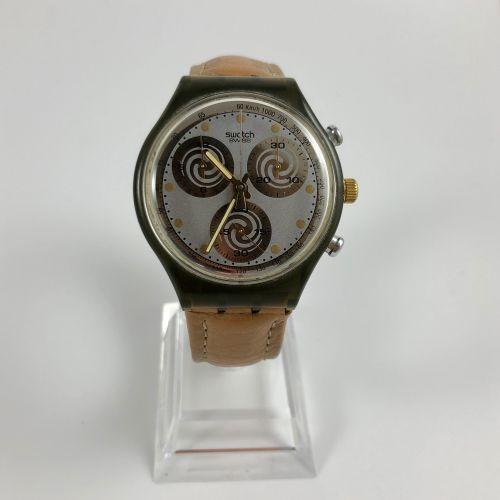 SWATCH. Chronographe. Cadran gris à spirale. Index ronds peints. Compteur des se…