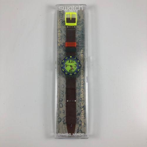 "SWATCH  Vers 1993.  Réf: SDN103.  Montre bracelet type scuba modèle ""Spay Up"".  …"