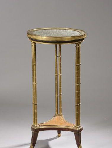 Tripod pedestal table in mahogany, mahogany veneer and amboina burr, the upright…
