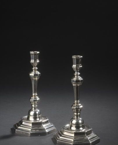 Pair of silver torches with cut off sides, the baluster shaft resting on an octa…