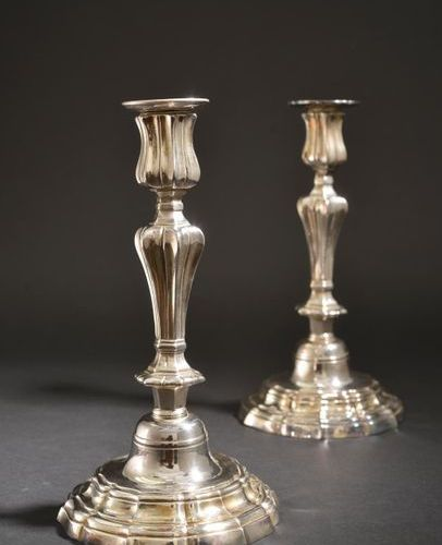 Pair of silver plated bronze torches, the tap and the barrel with pinched sides,…