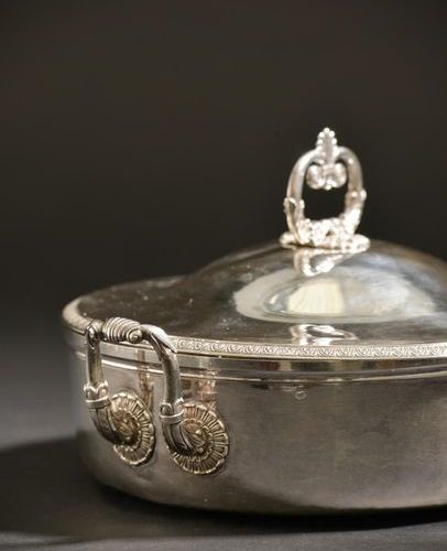 Silver covered vegetable dish edged with a frieze of palmettes, the fretel forme…