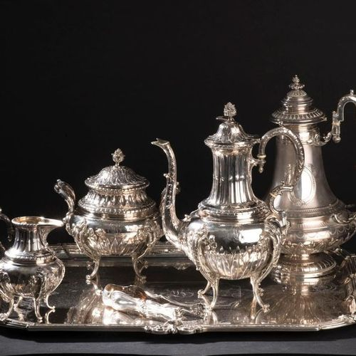 Silver coffee service part decorated with water leaves and palmettes, the fluted…