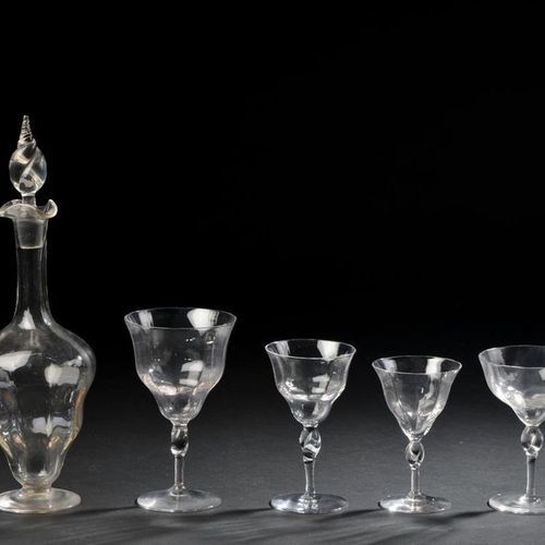 MURANO. Glasses service in blown glass with Venetian ribs, twisted leg. It inclu…