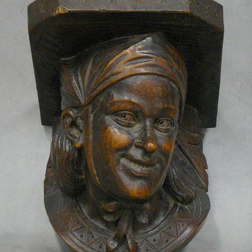 Une console murale en bois sculpté : tête de femme moyenâgeuse 19,5 x 19 x 16,5 …