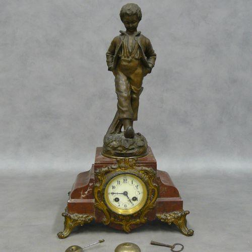 """Une pendule en marbre griotte surmontée d'une statuette en régule désignée """"prem…"""