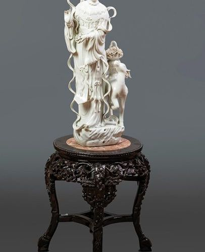"""Guanyin"" Big figure in porcelain ""blanc de chine"". On a carved wooden base with…"