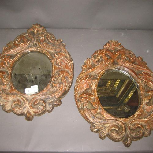 Pair of oval mirrors. Painted frame carved with foliage.  Old Italian work.  Hig…