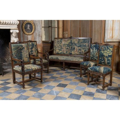 A Louis XIII style set of two armchairs, two chairs, and a sofa, XIXth century. …