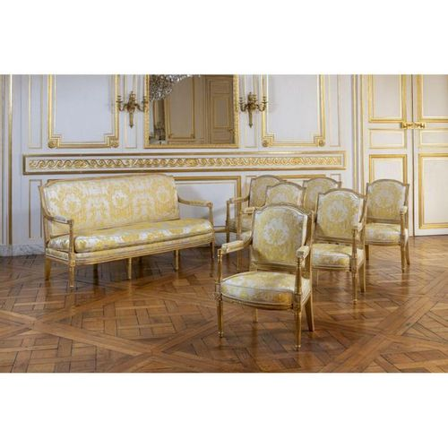 A set of six Louis XVI giltwood armchair and one sofa,  stamped by Pierre Eloi L…