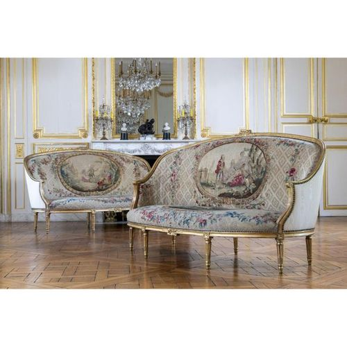 A set of two Louis XVI giltwood armchairs and two Louis XVI giltwood sofas, stam…