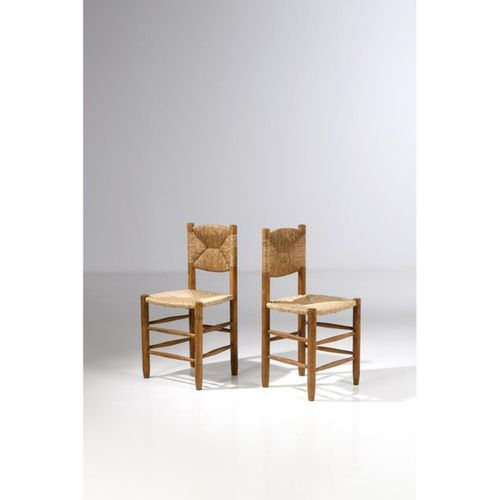 Charlotte Perriand (1903 1999)  Pair of 'Bauche' chairs model n°19  '  Ash and s…
