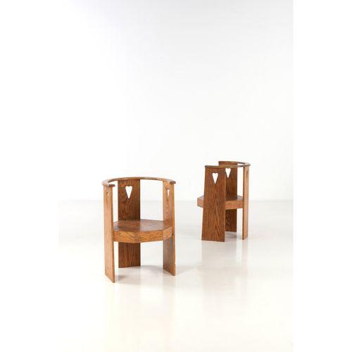 Eliel Saarinen (1873 1950)  Paire de fauteuils  Chêne  Modèle créé vers 1910  H …