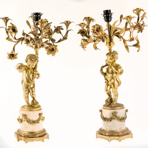 Pair of bronze candlestick plates Paire de chandeliers à cinq lumières, adaptés …