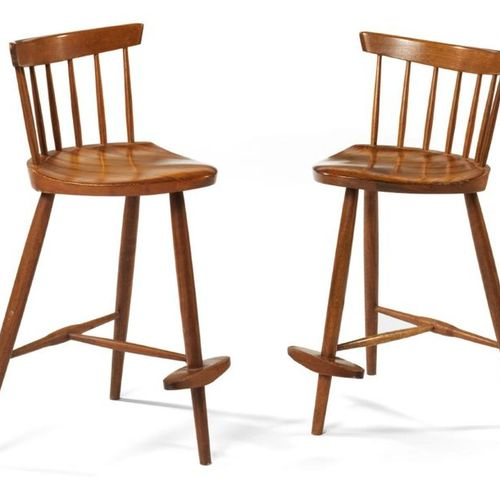 """George Nakashima (1905 1990) TWO """"MIRA"""" BAR TABOURETS In walnut, resting on thre…"""