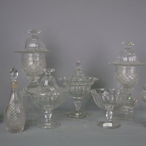 Set of cut crystal decanters and bowls.