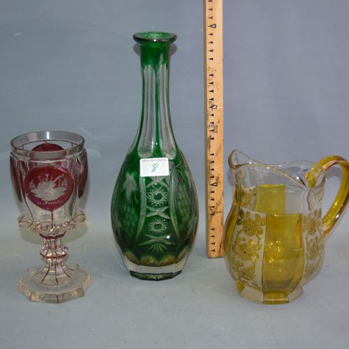A jug, a decanter without stopper and a collector's glass.