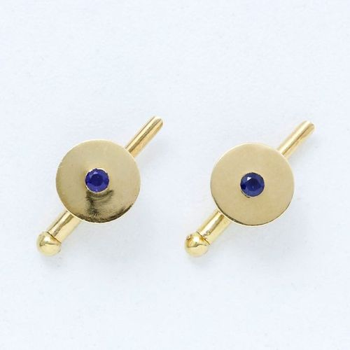 CARTIER  Pair of 750 thousandths gold collar buttons centred on a round facetted…