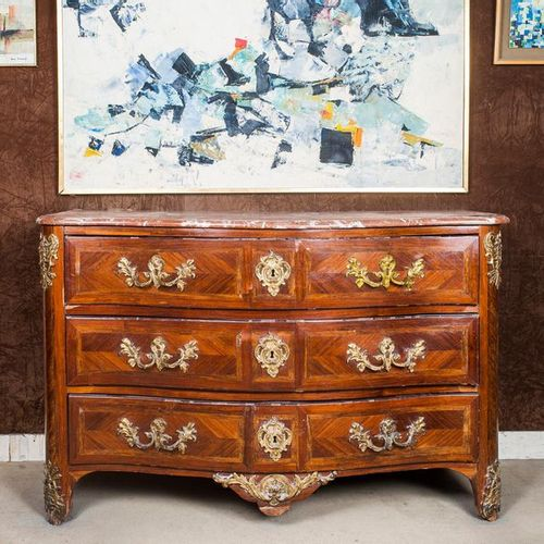 Louis XV period veneered chest of drawers  Curved front opening on three drawers…