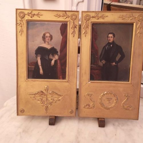 Two miniature portraits on panel in a gilded wood hinged frame.  Circa 1820 1830…