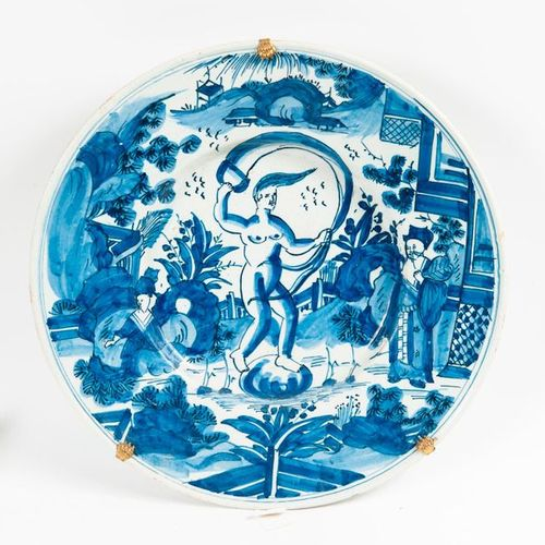 In the taste of Delft or Nevers, Round earthenware dish with Venus blue monochro…