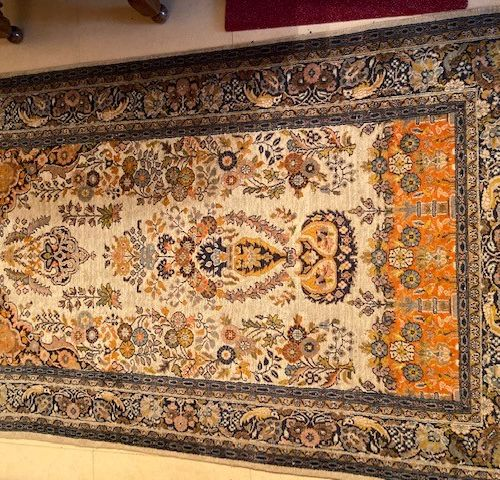 Wool and silk carpet with a floral vase decoration in the mirhab.  Cashmere. XXt…