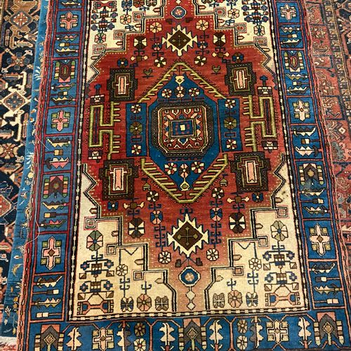 IRAN carpet with red background, blue border, geometrical decoration 200 X 135