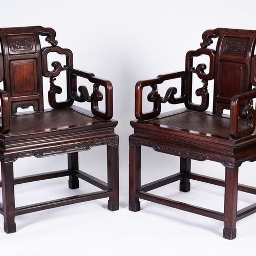 China, Pair of exotic wood armchairs carved with large backs and wide openwork a…