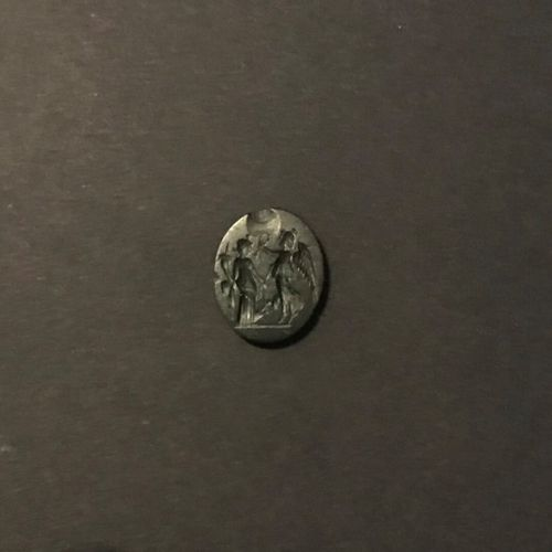 Oval and flat intaglio engraved with a Victory crowning a Tyche. Black jasper. R…