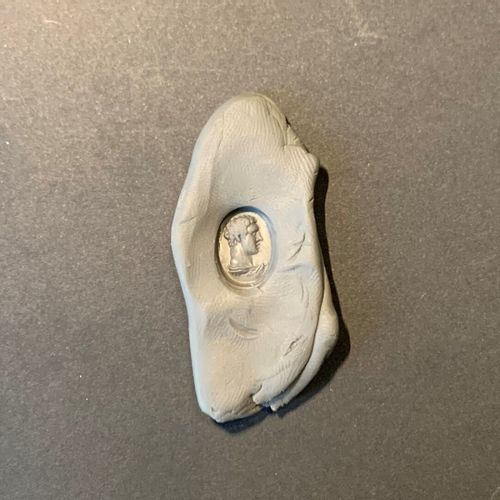 Flat oval intaglio engraved with a profile of a young Hercules with curly hair o…