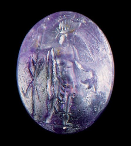 Convex oval intaglio engraved with a Bacchus standing on the right holding a spe…