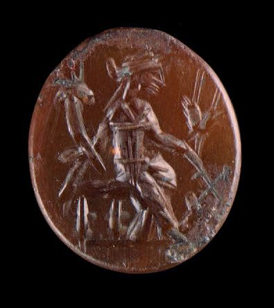 Flat oval intaglio engraved with a seated Tyché Fortuna. Carnelian. Roman art, 2…