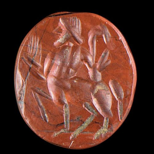 Flat oval intaglio engraved with a centaur passing to the left. Red jasper. Roma…