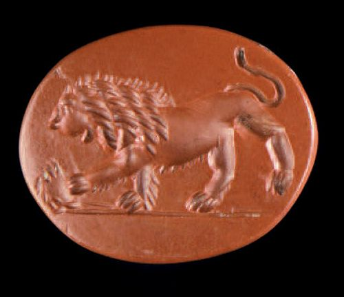 Flat oval intaglio engraved with a lion passing to the left and playing with a c…