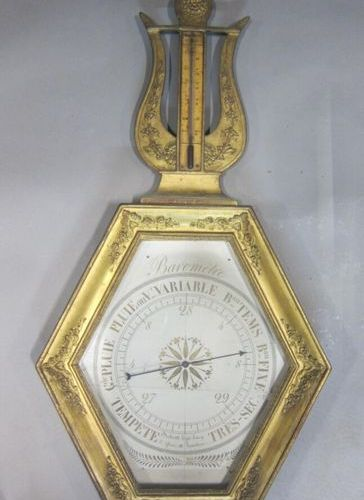 Wooden barometer thermometer with applied decoration of floral scrolls, the pain…