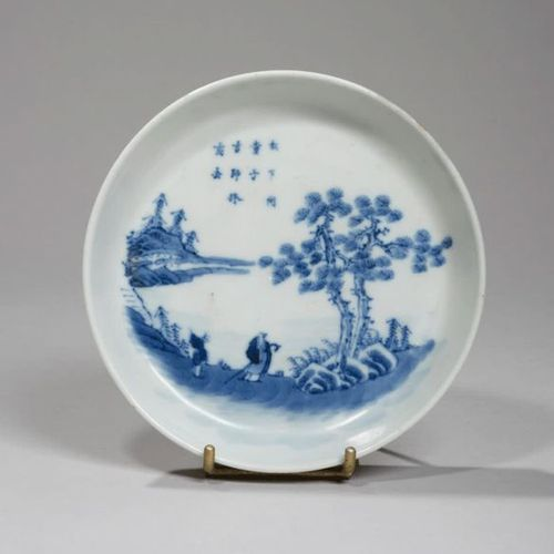 VIETNAM XIXe siècle Porcelain bowl decorated in blue with a couple of birds perc…