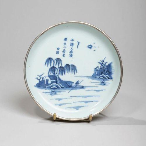 VIETNAM XIXe siècle Porcelain bowl with blue decoration under a man in a boat un…