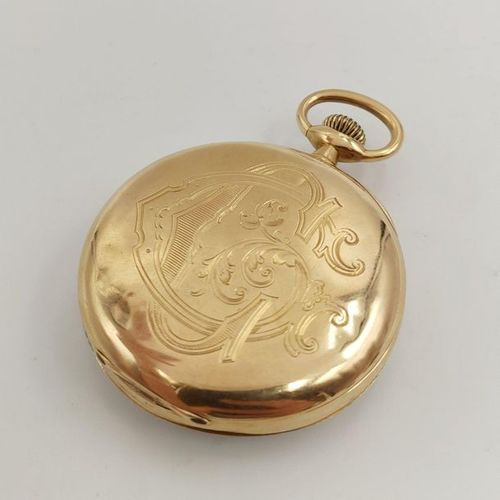 POCKET watch in yellow gold (750‰) monogrammed. White enamel dial (cracks, shock…