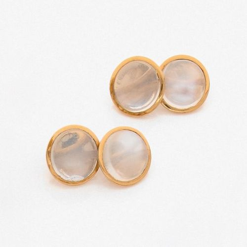 Pair of circular yellow gold SLEeves BUTTONS (750‰) decorated with four round ca…