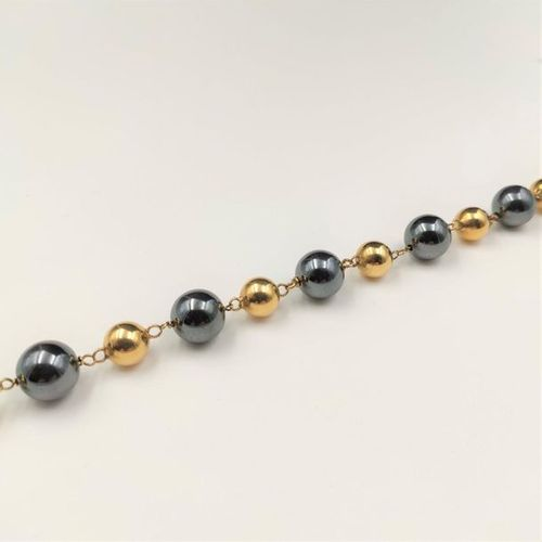 """BRACELET """"handcuffs"""" in yellow gold (750‰) composed of alternating balls of gold…"""