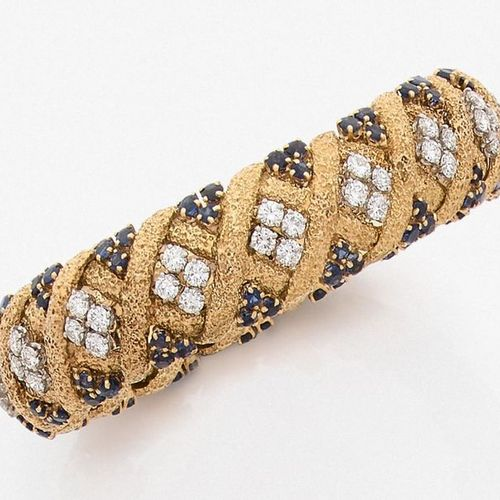 GUBELIN BRACELET in yellow gold (750‰) articulated, openwork and amati, with a c…