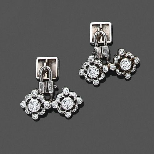 """Pair of """"two diamond"""" SLEeve BUTTONS in white gold (750‰) openworked set with br…"""