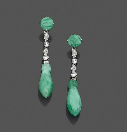 Pair of EARRINGS in platinum (800‰) and white gold (750‰) adorned with jade jade…