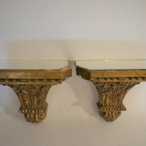 Pair of gilded wooden wall light consoles decorated with rows of pearls and foli…