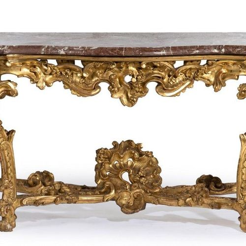 Large carved and gilded wooden console with rich rocaille decoration of sticks, …