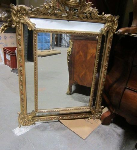 Mirror with gilded wooden brackets and vase. 109 x 88 cm