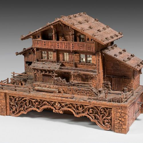 Curious music box forming a liquor and cigar cellar in the form of a Savoyard ch…